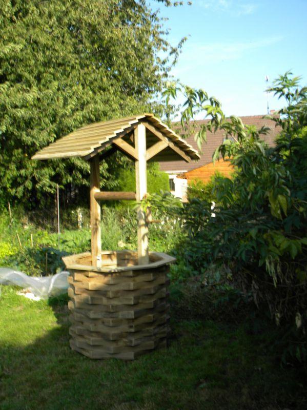 Les puits de d coration de jardin for Moulin en bois pour jardin